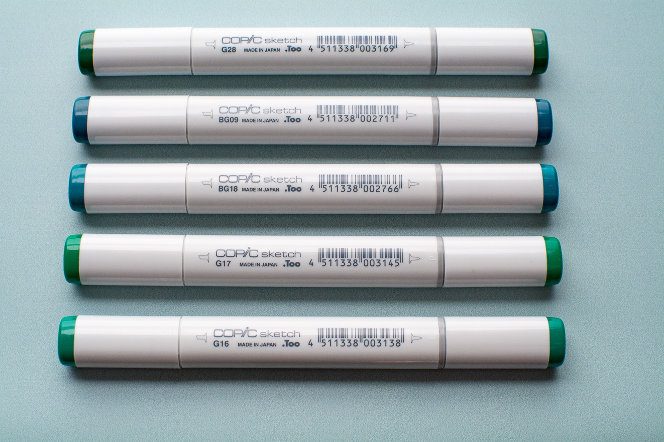 Photo of dark green Copic Sketch markers.