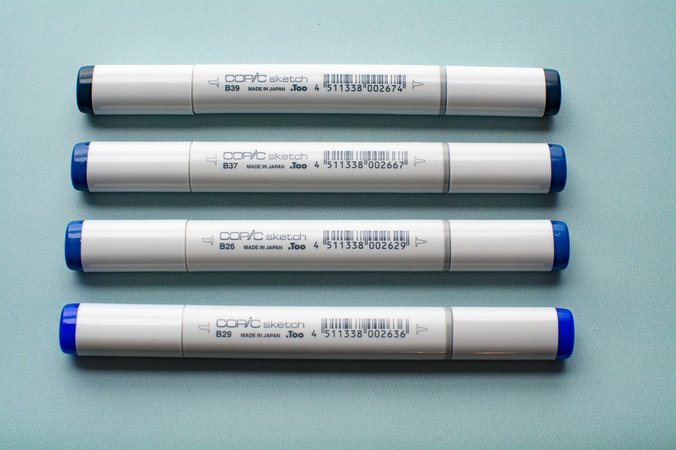 Photo of dark blue Copic Sketch markers.
