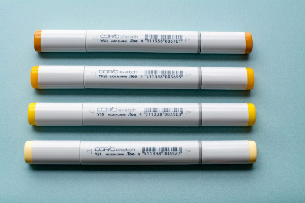 Photo of yellow-orange Copic Sketch markers from Set A