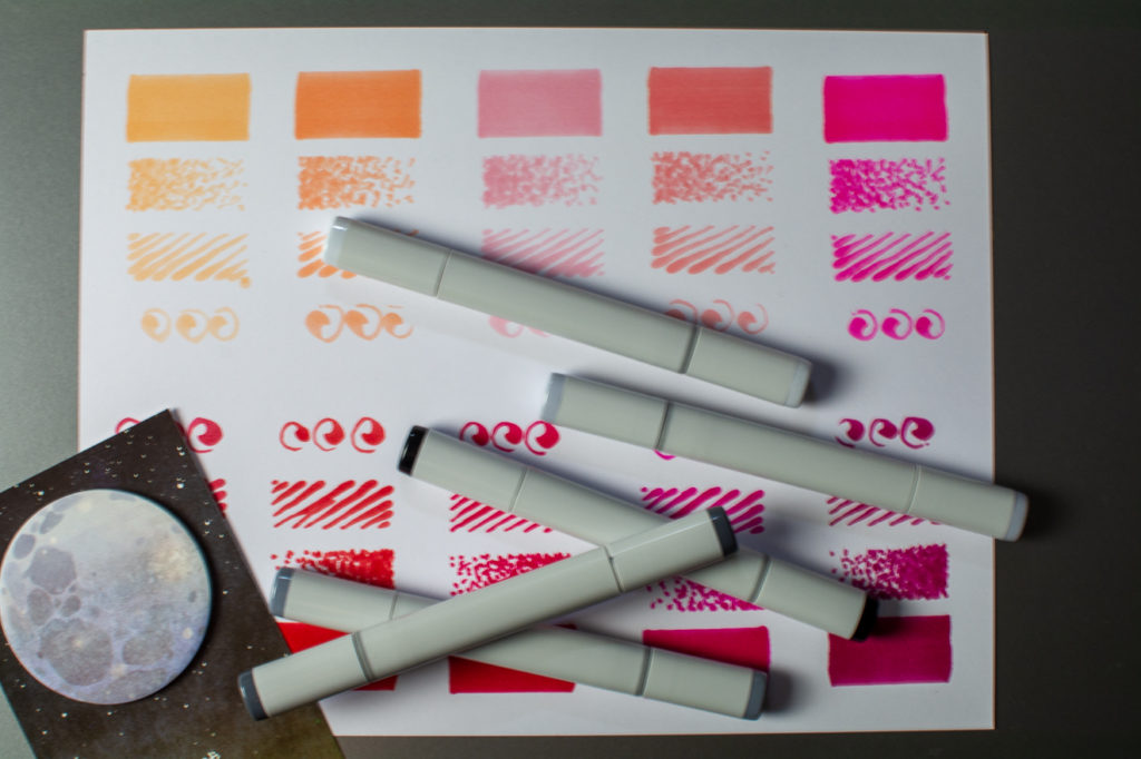 photo of pink copic sketch marker swatches