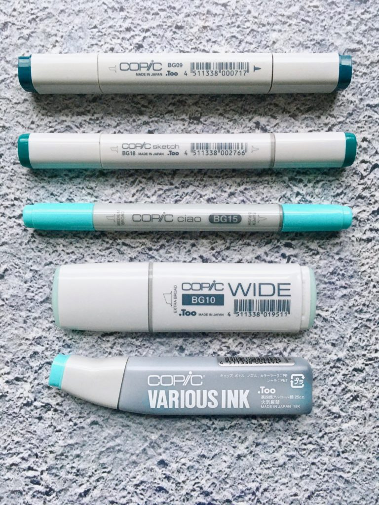 Photo of the 4 styles of Copic Markers: Original, Sketch, Ciao, and Wide and a bottle of replacement ink.
